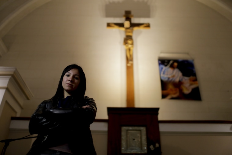 Yasmin Detez poses for a portrait inside San Jose Obrero church where Rev. Carlos Jose celebrated Mass in Caseros, in the province of Buenos Aires, Argentina. Detez, 25, says Jose abused her while she was a child.