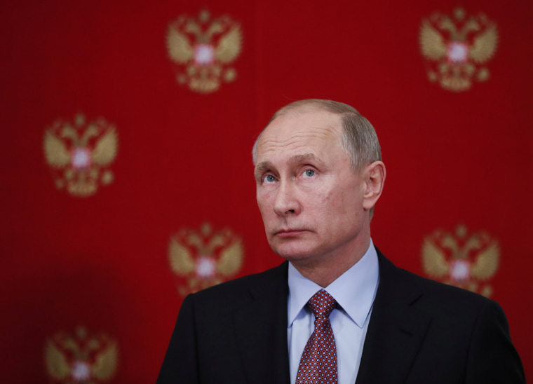 Image: Russian President Vladimir Putin attends a news conference at the Kremlin