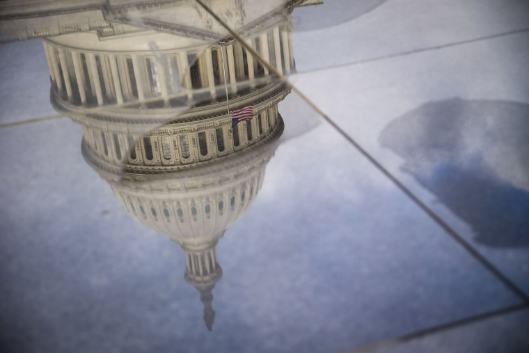 Image: The U.S. Capitol, seen in a reflection, in the morning in Washington.