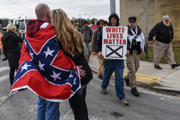 "Image: People participate in a ""White Lives Matter"" rally in Shelbyville"