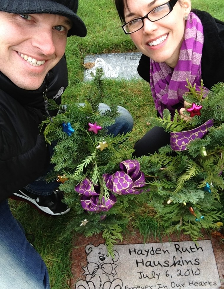 Randy and Rebekka Hauskins at the grave of their daughter, Hayden, who was stillborn in 2010.