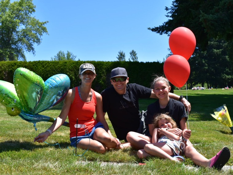 The Hauskins family: Randy, Rebekka, Madison, 13, and Josie, 5, visiting Hayden's grave on her seventh birthday.