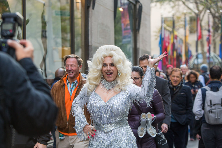 Matt Lauer revived a TODAY Halloween tradition by letting his hair down and dressing as a famous woman from pop culture, in this case, Dolly Parton.