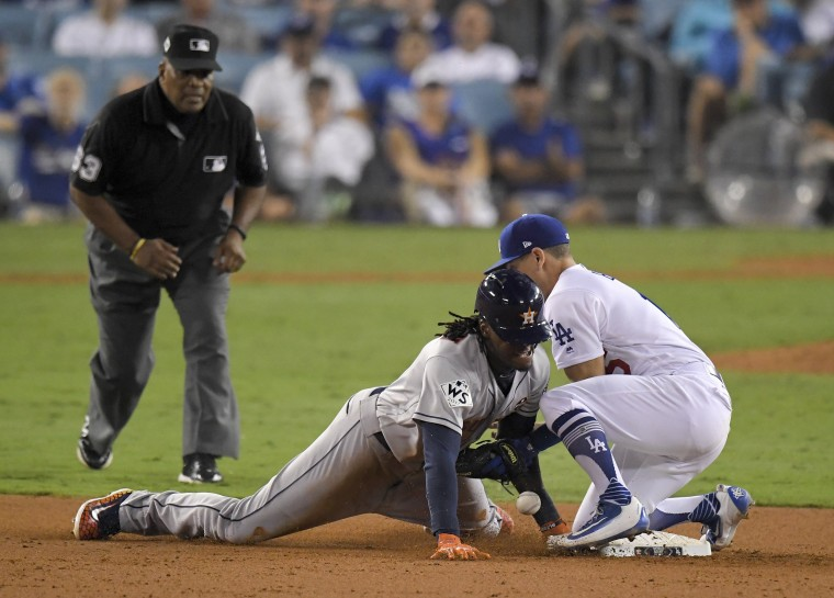 Houston Astros' Cameron Maybin, left, steals second past Los Angeles Dodgers Austin Barnes during the 11th inning of Game 2 of baseball's World Series Wednesday, Oct. 25, 2017, in Los Angeles.