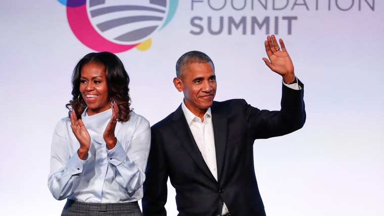 Image: Former U.S. President Barack Obama and former first lady Michelle Obama arrive for the Obama Foundation Summit in Chicago