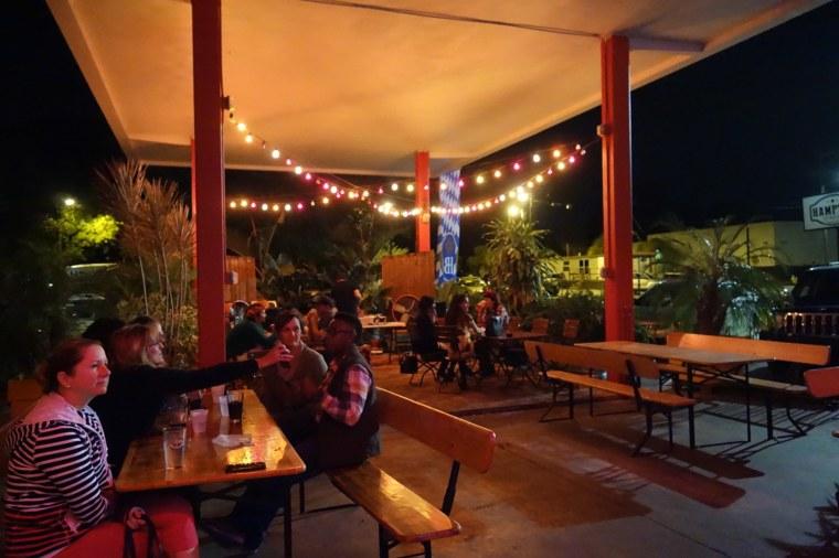 Hampton Station's outdoor patio, at night.