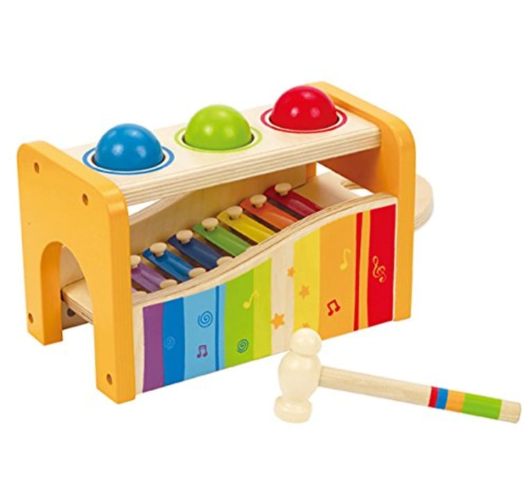 Pound and tap bench with slide out xylophone