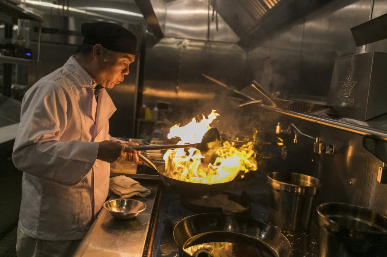 Image: Chen Lieh Tang cooks a dish in the Hwa Yuan kitchen