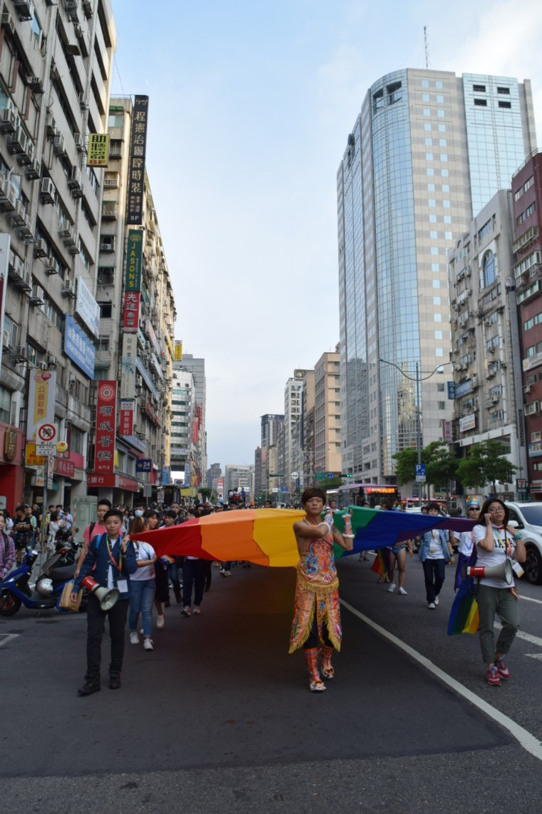 Marchers carry a rainbow flag at the 15th annual Taiwan LGBT Pride event in Taipei.