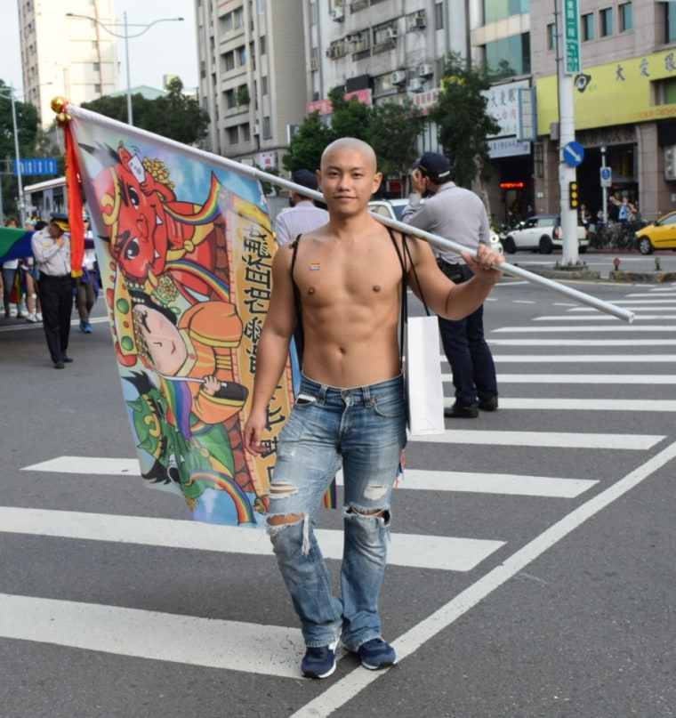 A parade-goer at Taipei's pride parade poses for a photo.
