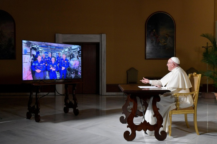Image: Pope Francis talks with crew members of the International Space Station, ISS Expedition 53, during an audio-video connection at the Vatican