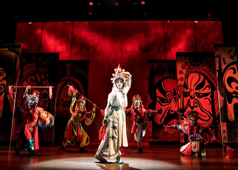 "Jin Ha (center) portrays Song Liling in ""M. Butterfly."""