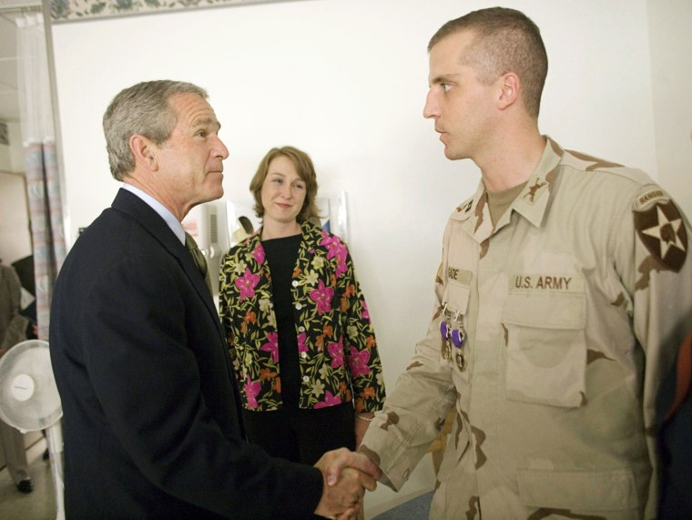 Image: President George W. Bush shakes the Capt. Daniel Gade