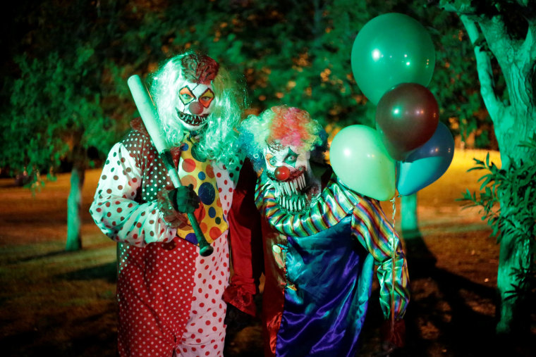 Image: Men dressed as clowns pose for a photo during a Halloween party in Ciudad Juarez, Mexico on Oct. 27.