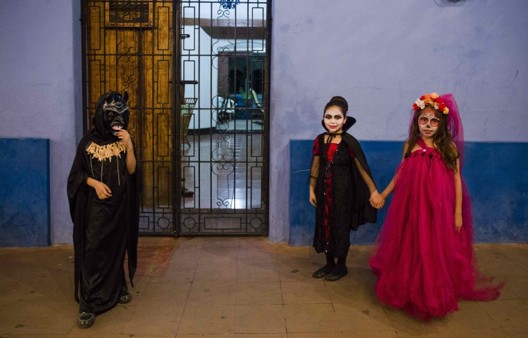 Image: Children dressed as witches and demons for the 'Los Aguizotes' celebration in Masaya, Nicaragua on Oct. 27.