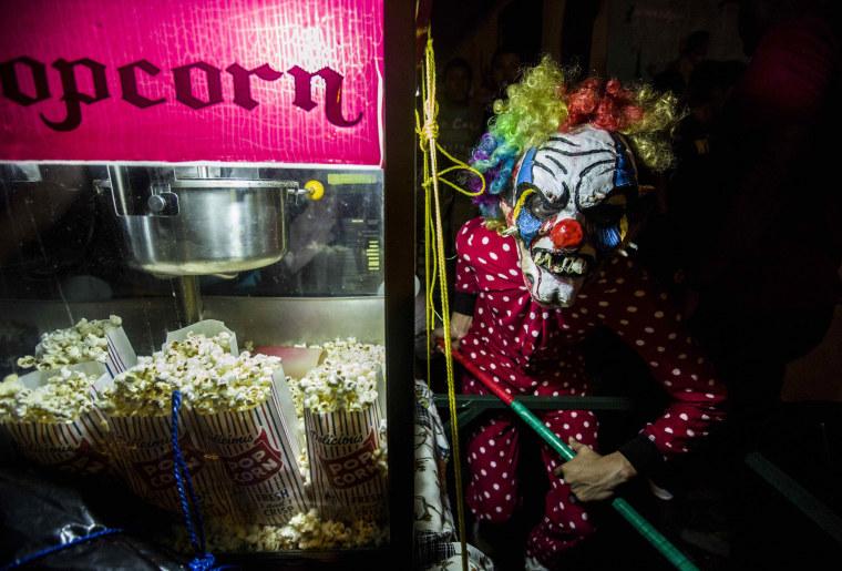 Image: A reveler participates in the 'Los Ag?izotes' celebration on Oct. 27.