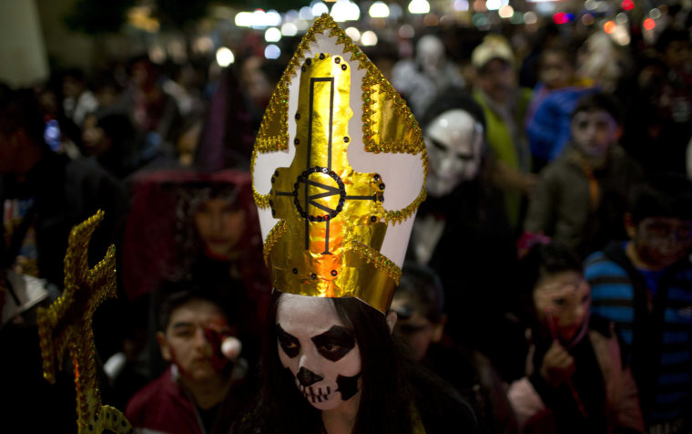 Image: A woman dressed as a Catholic priest zombie participates in the annual Zombie Walk in La Paz, Bolivia on Oct. 28.