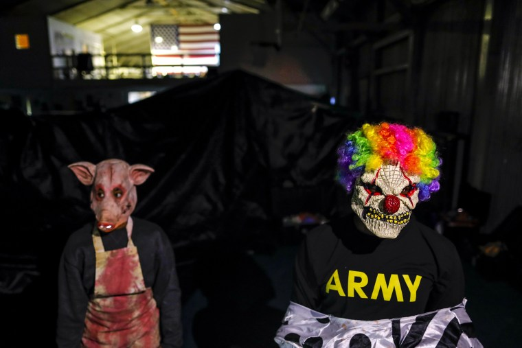 Image: U.S. soldiers serving in the NATO peace keeping mission in Kosovo (KFOR) wear masks while taking part in a Halloween party at the U.S. military camp Bondsteel in the village of Sojeve, near the town of Ferizaj, Kosovo on Oct. 29.