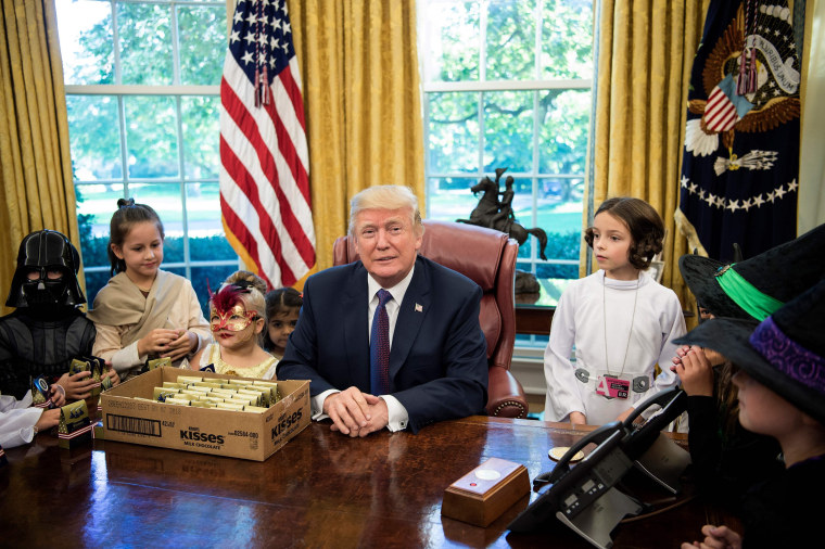 Image: President Donald Trump meets with the children of members of the press for Halloween in the Oval Office of the White House in Washington on Oct. 27.