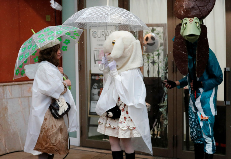 Image: Participants in costumes stand under the rain during a Halloween event in Kawasaki, Japan on Oct. 29.