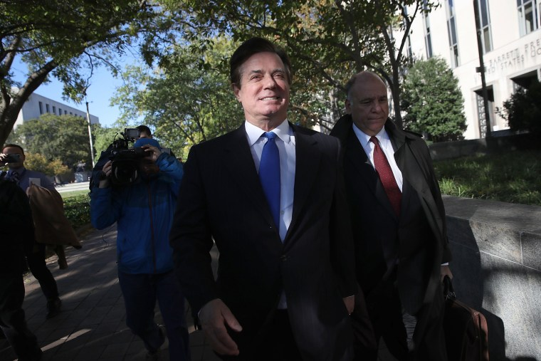 Image: Paul Manafort leaves U.S. District Court after pleading not guilty