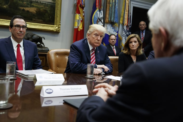 Image: Trump listens during a meeting on tax policy with business leaders