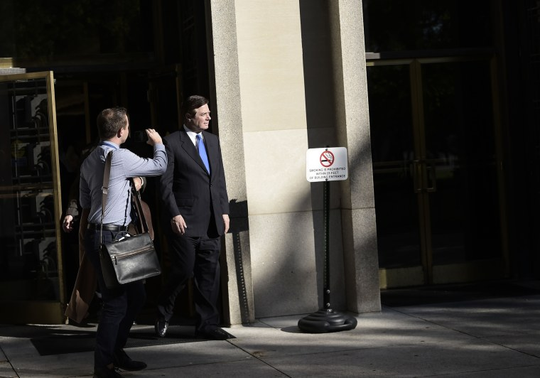 Image: Paul Manafort walks outside the William B. Bryant US Courthouse