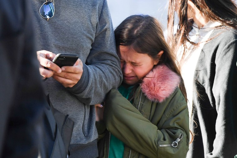 Image: A young girl reacts to a shooting