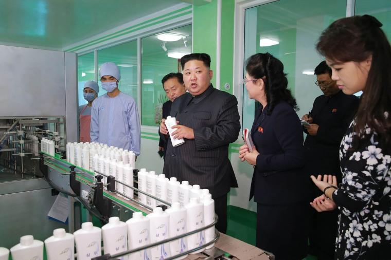 Image: Kim Jong Un visits a cosmetics factory