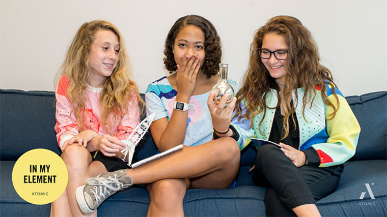A group of girls wear apparel from Atomic By Design clothing line.