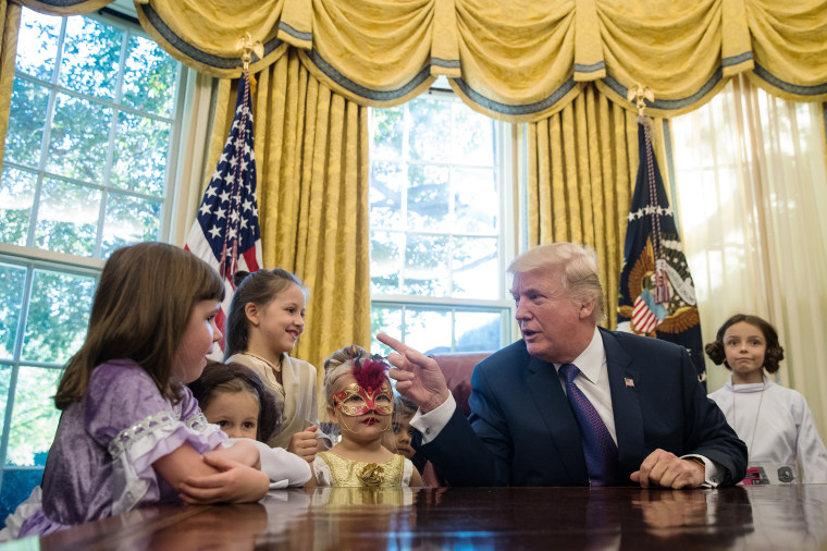 Image: *** BESTPIX *** President Trump Hosts Children Of White House Journalists In Oval Office For Halloween