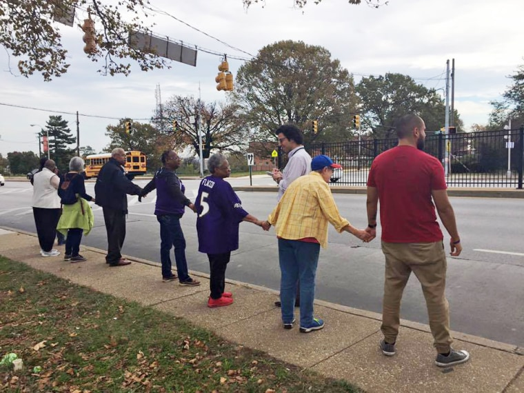 """Image: \""""Baltimore Ceasefire forming human chain along Edmondson Ave\"""" on Nov. 3, 2017 in Baltimore"""
