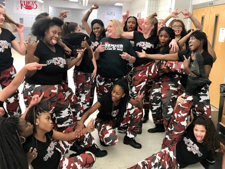 Lake Mary High School principal Dr. Mickey Reynolds poses with members of the school's step team after their surprise pep rally performance.