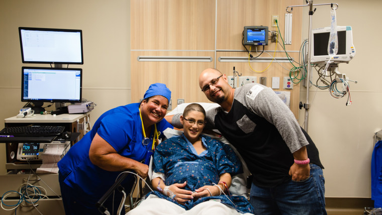 Maria Crider, pictured here with her doctor and husband Brandon, was 11 weeks pregnant when she was diagnosed with breast cancer.
