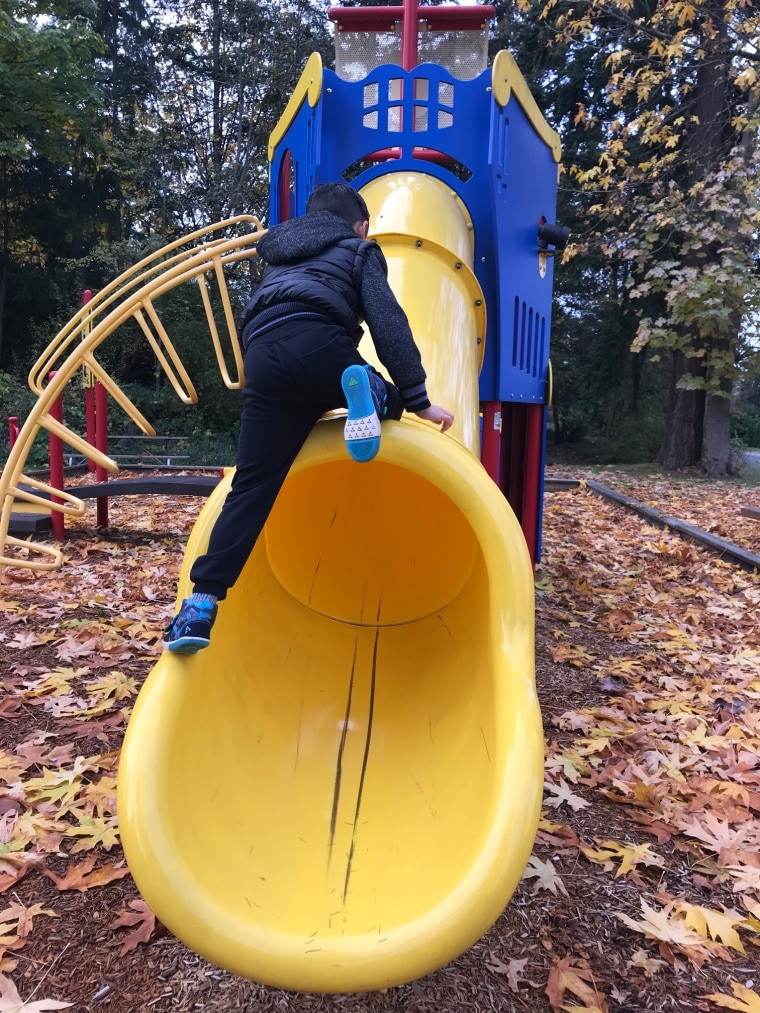 """""""Young kids are testing personal limits because their bodies keeps changing. Once they can figure out their limit, they stay within it. Climbing up a slide as a way of experimenting,"""" says parenting expert Heather Shumaker."""