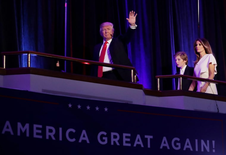 Image: Trump acknowledges the crowd along during his election night event