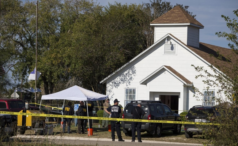Image: Law enforcement officials works at the scene of a fatal shooting