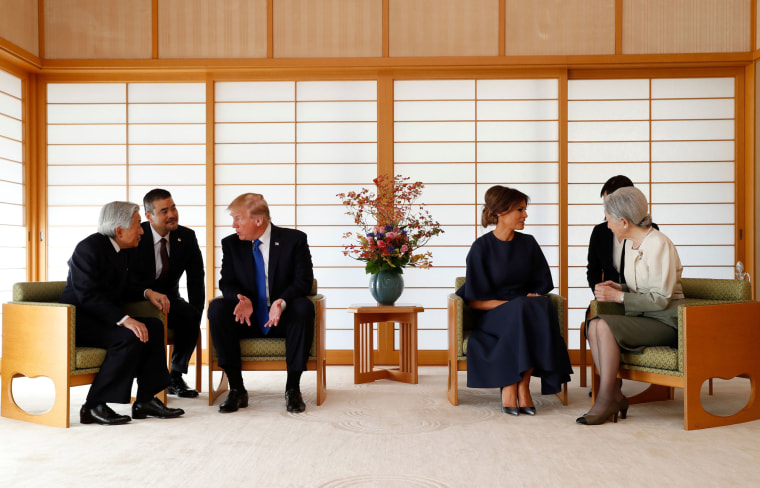 Image: Japan's Emperor Akihito, left, speaks with Trump, while First Lady Melania Trump talks with Empress Michiko at the Imperial Palace on Nov.6.