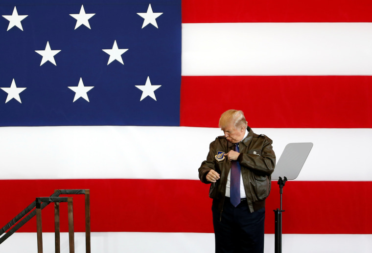 Image: President Trump points to a detail on his flight jacket while on stage at U.S. Air Force Yokota Air Base.