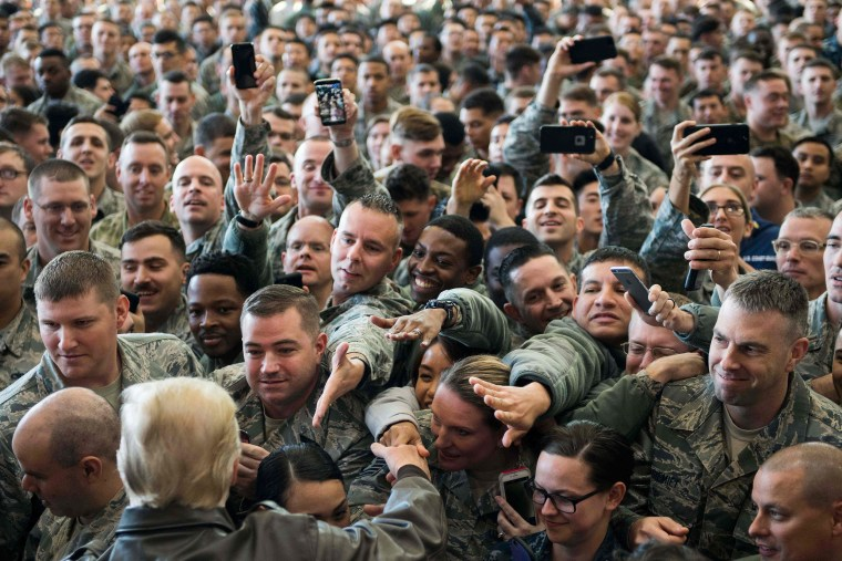 Image: President Trump greets U.S. troops after speaking during an event with military personnel at Yokota Air Base.