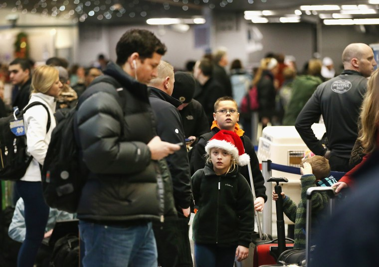 Image: Holiday Travelers Crowd Airports Ahead Of The Holidays