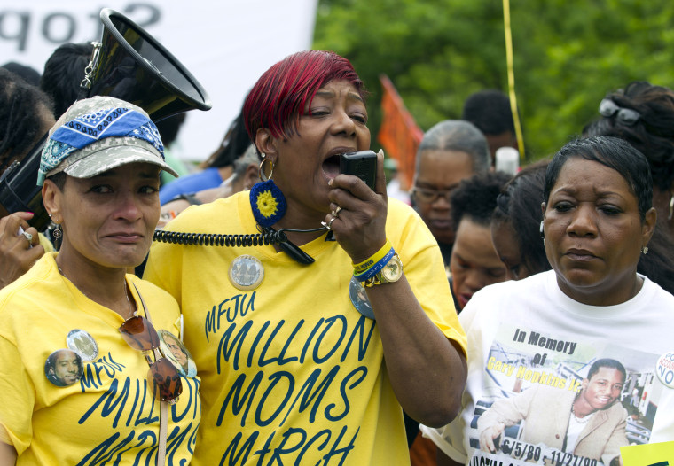 "Maria Hamilton, center, the mother of Dontre Hamilton, who was killed by a police officer in a park in Milwaukee, speaks to group of mothers marching against police brutality at the ""Million Moms March"" in Washington on May 9, 2015."