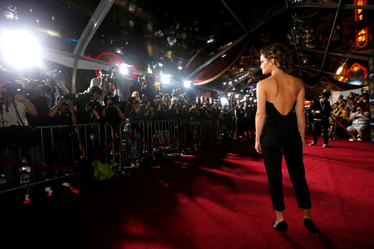 """Image: Emma Watson poses at the premiere of \""""Beauty and the Beast\"""" in Los Angeles"""