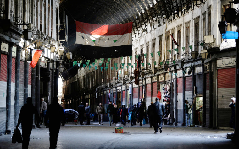 Image: Syrian vendors open their shops at the Hamidiya market