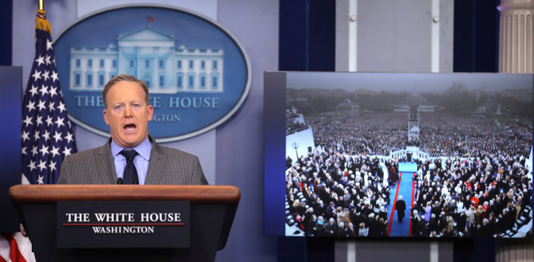 Image: Press Secretary Sean Spicer delivers a statement while television screen show a picture of U.S. President Donald Trump's inauguration at the press briefing room of the White House in Washington U.S.