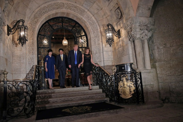 Image: U.S. President Donald Trump, First Lady Melania Trump (R), Japanese Prime Minister Shinzo Abe and his wife Akie Abe (L) pose for a photograph before attending dinner at Mar-a-Lago Club in Palm Beach, Florida, U.S.