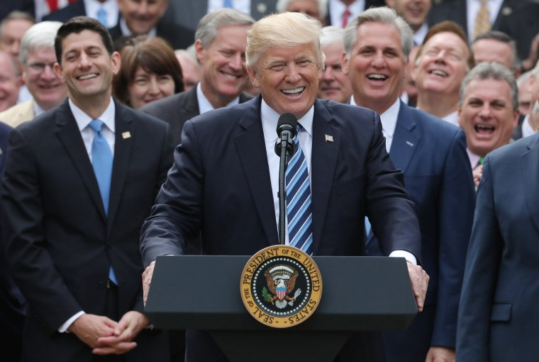 Image: U.S. President Trump celebrates with Republican House members after healthcare bill vote at the White House in Washington