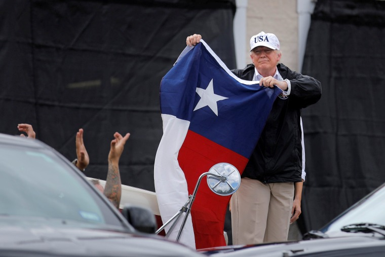 Image: U.S. President Trump holds a flag of the state of Texas in Corpus Christi