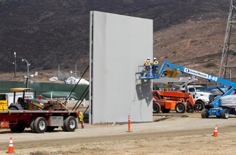 Image: People work in San Diego, California, U.S., at the construction site of prototypes for U.S. President Donald Trump's border wall with Mexico, in this picture taken from the Mexican side of the border in Tijuana, Mexico