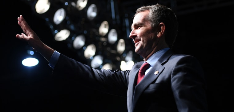 Image: Democratic Gubernatorial Candidate Ralph Northam waves as he arrives to speak during a campaign rally
